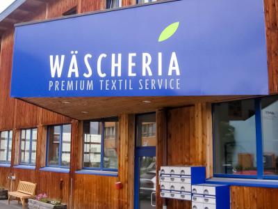 Wäscheria: Gebäudebeschriftung